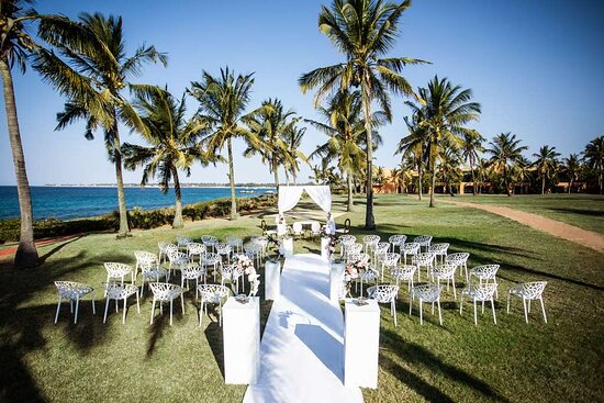 Exterior view over wedding setup on lawn with ocean view