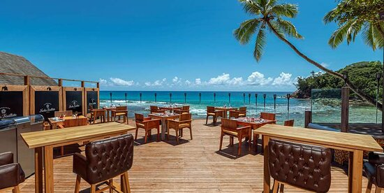 Exterior view of outdoor seating areas at The Terrace Restaurant with ocean view