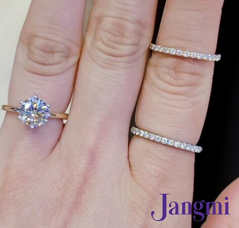 2ct Round cut diamond on our two tone love six prong elegant solitaire