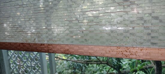 Regular Room: details of the stains on the bottom of the sheer blinds