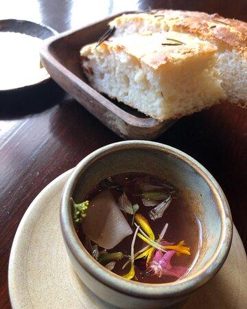 Complimentary  focacciia, rhubarb and coriander tea.