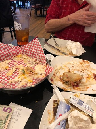 Albertville, AL: We had Nachos with chicken and colossal potato with pork. We would give the food a 10. It was delicious smoked flavor.