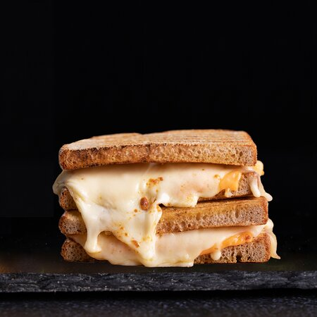 Ultimate Grilled Cheese  Mozzarella Cheese + Cheddar Cheese + American Cheese on a Toasted Sourdough