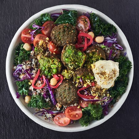 Cleopatra Signature Bowl  As the last Queen of the Kingdom of Egypt, Cleopatra was described as a woman of surpassing beauty and a romantic femme fatale. Her accomplishment as a successful woman leader led her to become a role model for all women living in her time.  Authentic Egyptian Falafels on a bed of Quinoa + Purple and White Cabbage + Kale + Cherry Tomatoes + Chickpeas + Pickled Turnips + Dukkha + Sesame Seeds + Hummus, Lemon Dressing with a drizzle of Tahini