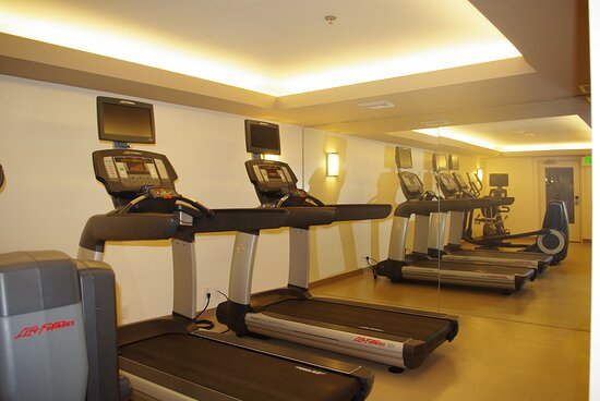 Newly upgraded hotel fitness center with personal viewing screens