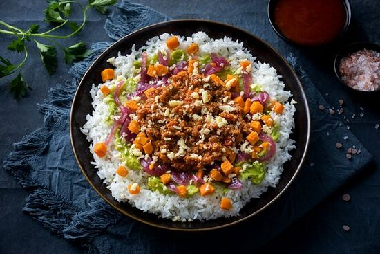 Beef BBQ Rice Bowl- Rice bowl with warm ground beef, shredded cheddar cheese, roasted sweet potatoes, avocado mash, and pickled red onions with your choice of a sauce (served on the side).