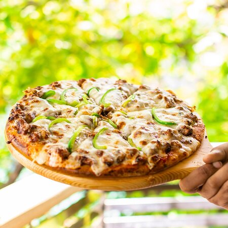The Dreams Pizza. Deliciously dressed with green, Beef and Chicken Pizza