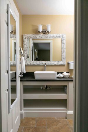 Each room has an attached a full bathroom with either a tub/shower combo or a standing shower.