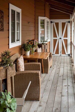 A cozy porch to enjoy the nature that surrounds the J. Patrick House & Inn!