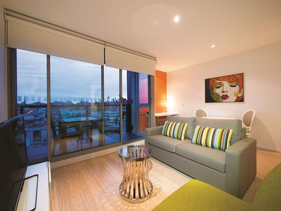 Interior view of lounge in One Bedroom Suite with city view
