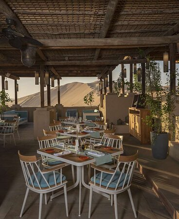 Outdoor seating set-up at Ghadeer Restaurant with desert view