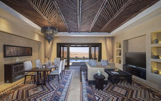 Interior view of living room in Three Bedroom Villa with desert view over terrace and pool