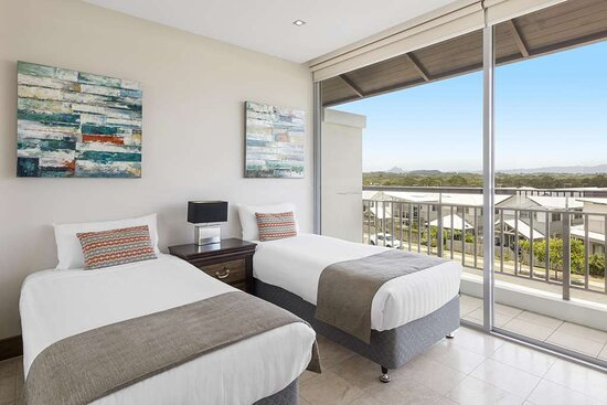 Interior view of twin room in One Bedroom Family Room with balcony