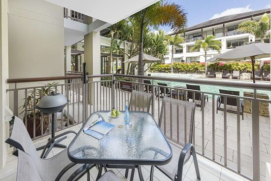 Dining area on balcony of Studio Pool Room with pool view