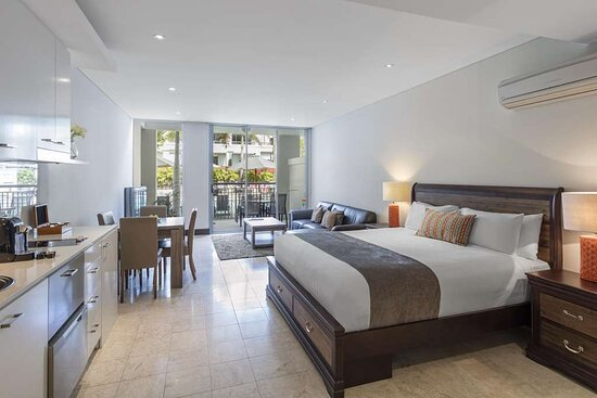 Interior view of bedroom in Studio Room with living area and balcony