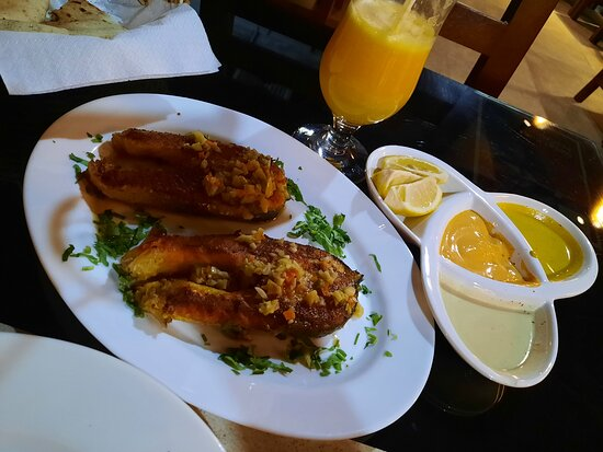 Grilled Salmon (250gm) in lemon oil and garlic butter sauce Fresh Orange Juice