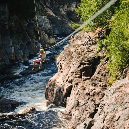 Our 1000 foot canyon zipline! Fly over these rapids and take in the stunning view!