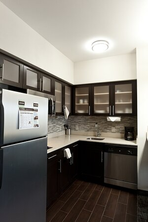 Guest room kitchens with full sized refrigerators at Staybridge