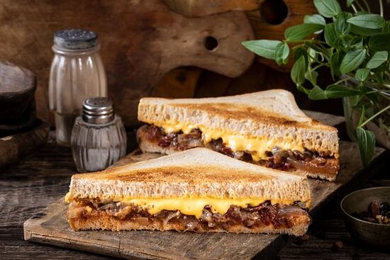 Cheddar Beef Bacon Grilled Cheese- Grilled Cheese sandwich with cheddar cheese and beef bacon bits. Served on toasted brioche.