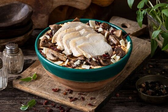 Bacon Padano Mash- Mashed potato bowl mixed with almond habanero mash and topped with roasted chicken, parmesan cheese, roasted mushrooms, and beef bacon bits. Toppings are served chilled over warm mashed potatoes.