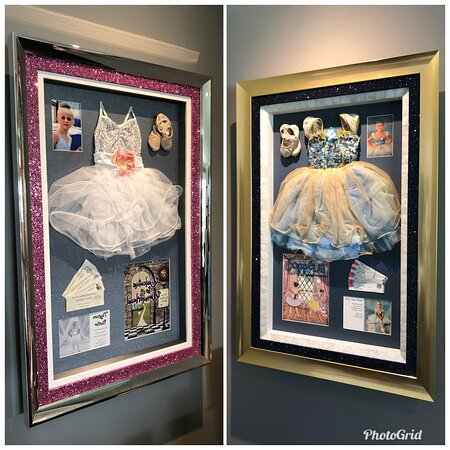 Dance tu-tut, slippers, performance catalogue, tickets, and photographs in a Frame of Mind Glitter custom frame stacked under a mirrored moulding.