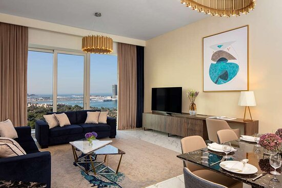 Superior Sea View Three Bedroom Apartment living room with two sofas and a dining table