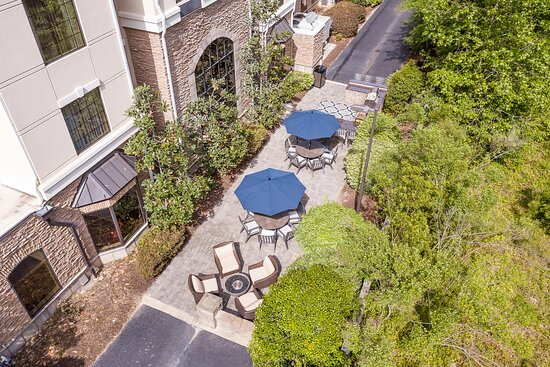 Relax on our beautiful patio featuring grill stations & a firepit