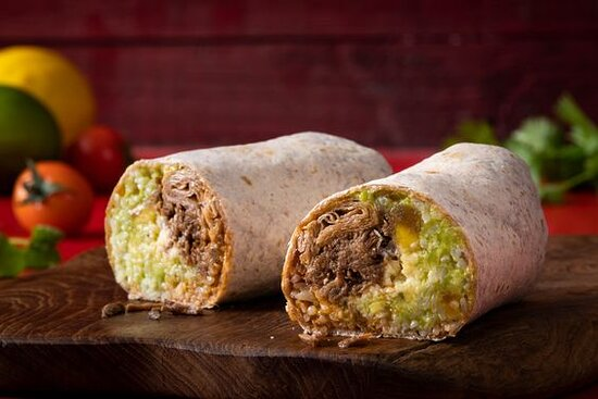 Juarez BBQ Style Burrito- Mexican burrito with shredded beef, cheddar cheese, guacamole, red onions, and Brooklyn BBQ sauce. Served with white rice in a wheat wrap.