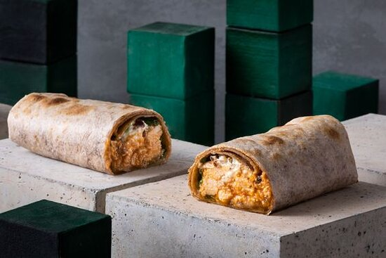 BBQ Chicken Wrap- BBQ Chicken with Romaine Lettuce and your Choice of Toppings, Cheese and Sauce, Toasted in a Whole Wheat Wrap.