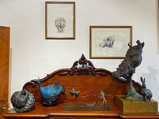 Bronze sculptures and Stephen the sculptor in the studio