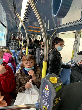 """The light rail train carriages are all packed today on our """"sand-of-the-season"""" holiday (and probably everyday)."""