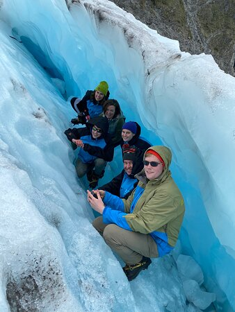 Heli Hike Fox Glacier: The family in a small ice cave