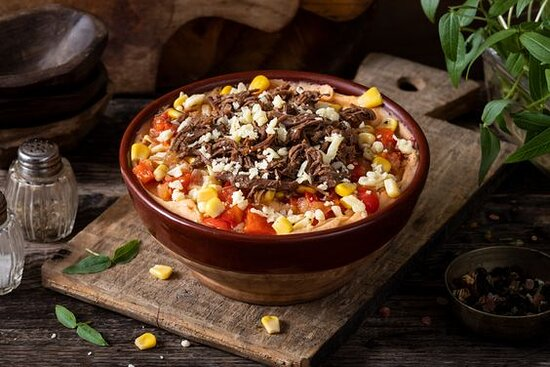 Barbeque Beef Mash- Mashed potato bowl mixed with Brooklyn BBQ sauce and topped with warm shredded beef, shredded cheddar cheese, seasoned corn, and sautéed peppers and onions. Toppings are served chilled over warm mashed potatoes.