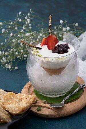 Cardamom and palm sugar panna cotta   Spiced seasonal fruit compote