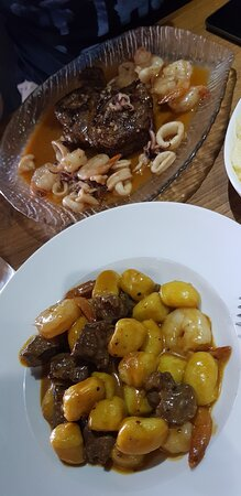 Sderot, Israel: steak with seafood mix and gnocchi meat and shrimp mix