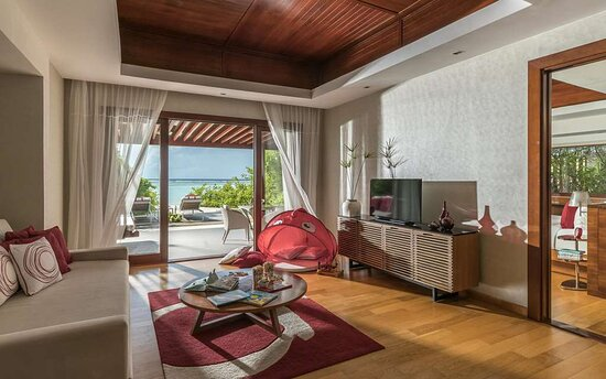 An interior shot of the living room of a Family Beach Pool Villa with beach access and stunning view outside.