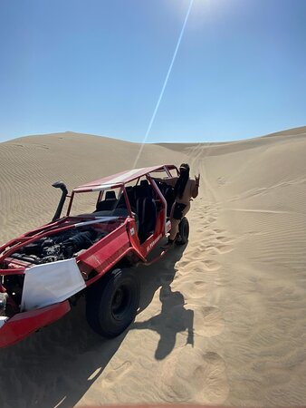 """The famous Oasis called Huacachina. 09-Nov-2020. The huge white sand dunes surrounding the Huacachina lagoon are perfect to practice one of the ultimate sports in the area """"Sandboarding."""