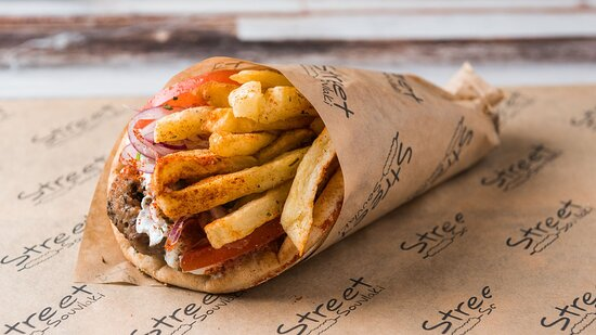 Pita wrap Grilled beef meatballs (tomato, lettuce, sauce, fries)