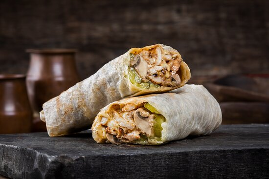 Mushroom Chick Shawarma- Chicken Shawarma with Emmentaler Cheese, Cheese Sauce, Roasted Mushrooms, and Pickles. Wrapped in Saj.