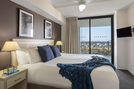 Interior view of master bedroom with access to balcony