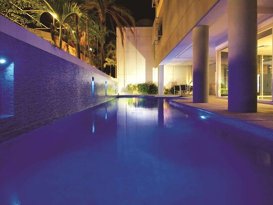 Exterior view of swimming pool at night