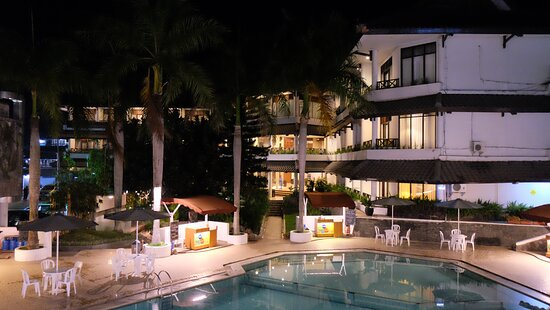 Hotel's natural hot spring water swimming pool at night.