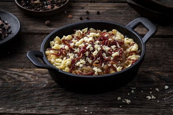 Beef Bacon- Mac and Cheese with beef bacon bits, cheddar cheese and caramelized onions.