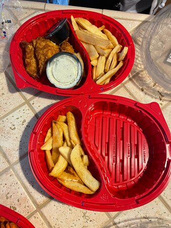 """Fish and chips with the """"extra bottomless"""" fries to go"""