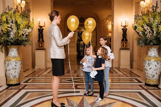 Lobby with Front Desk Staff and Children