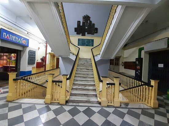 The lobby in the old wing, showing the marble floor and antique wooden staircase