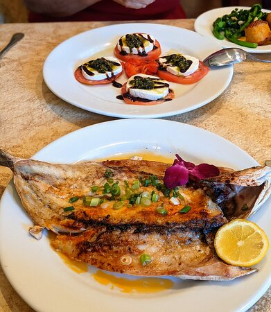 Caprese Salad and Grilled Bronzino (Robalo) served with potatoes and broccoli rabe