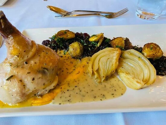 Half game hen with wild rice pilaf, squash purée, braised fennel, roasted Brussels sprouts and herbed white wine sauce.