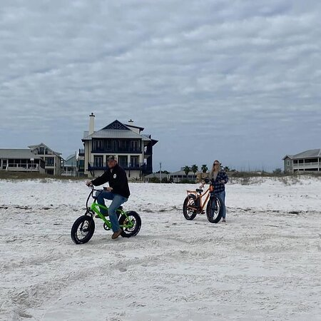 Rent an electric bike and ride on the beach