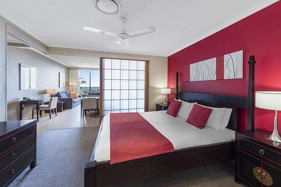Interior view of bedroom in One Bedroom Premier Ocean View Suite with living room view